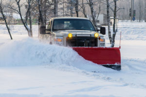 car pickup cleaned from snow by a snowplough during wintertime