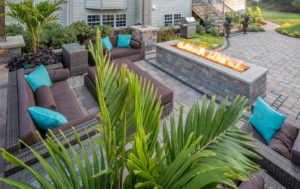 outdoor patio with furniture and fireplace