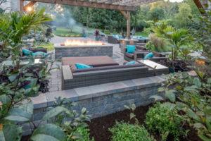 large patio with seating and fire pit