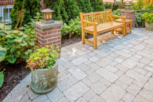patio with plants and bench