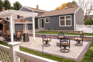 flat patio in backyard with seating