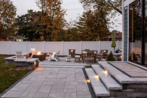 outdoor patio with new stone work and lighting