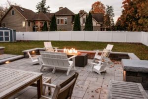 outdoor fireplace on patio with seating around the fireplace